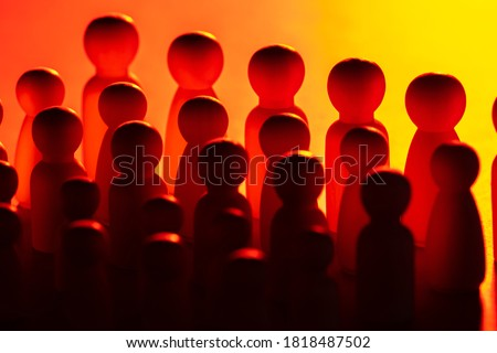 The concept of the state. Political parties or the army. The silhouettes of a multitude of faceless people. People without individual traits. Royalty-Free Stock Photo #1818487502