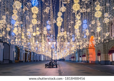 Christmas Moscow. Christmas celebration in Moscow. A Christmas tale in the capital of Russia.The city street is decorated with garlands. New year in Moscow. City decorations. Festive evening in Russia #1818488456