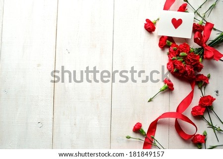 Red carnations bouquet with message card.Image of Mothers day. #181849157