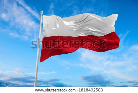 Large poland flag waving in the wind Royalty-Free Stock Photo #1818492503
