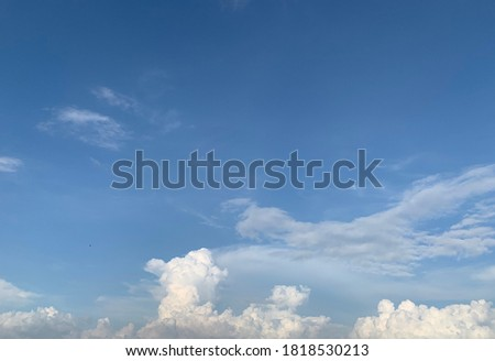 In the clear blue sky there are both Cirrus clouds and beautiful white Cumulus clouds. Royalty-Free Stock Photo #1818530213