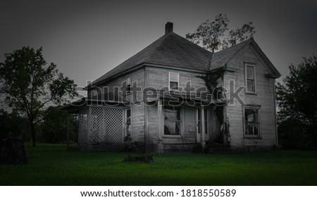 An abandoned home in Joplin, Missouri Royalty-Free Stock Photo #1818550589