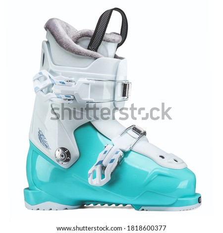 Teal Blue Ski Boot Isolated on White. Tour Carbon Ski Boots. Ski Equipment. Alpine Touring Boot Side View. Snowboarding Protective Gear. Modern Winter Shoes for Alpine and Cross Country Skiing Royalty-Free Stock Photo #1818600377