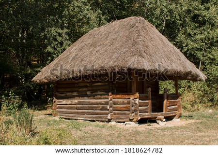an old thatched house in the forest Royalty-Free Stock Photo #1818624782