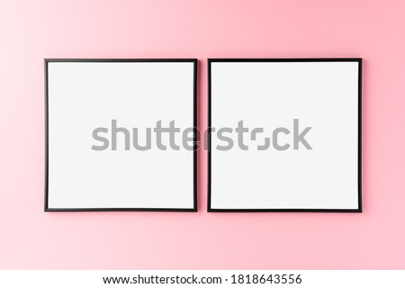 Mockup of two empty photo frames on pink background. Home decoration