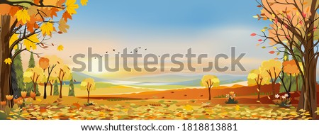 Autumn landscapes of Countryside with sunset and blue and pink sky,Panoramic of mid autumn with farm field, mountains, leaves falling from trees in orange foliage. Wonderland in fall season Royalty-Free Stock Photo #1818813881