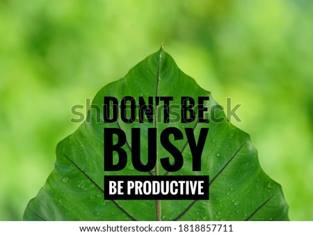 Taro leaf isolated on green blurry background with Typography of Inspirational quote in work, do not be busy, be productive  Royalty-Free Stock Photo #1818857711