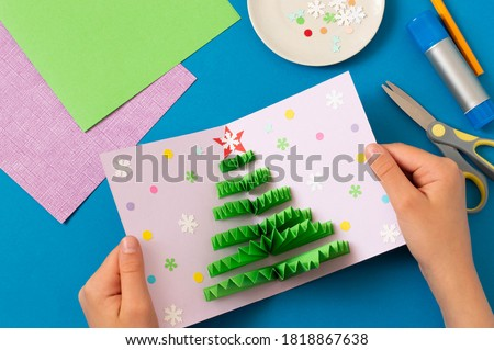 How to make Christmas card with volumetric tree. Original project for children. DIY concept. Step-by-step photo instructions. Step 9. Decorate card with confetti and snowflakes  #1818867638