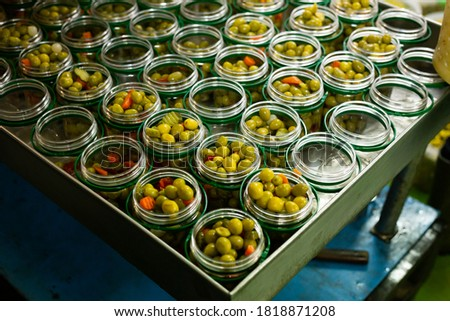 Olives and other ingredients in glass jars for canning. High quality photo