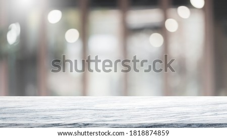 Empty white marble stone table top and blur glass window interior cafe and restaurant banner mock up abstract background - can used for display or montage your products.