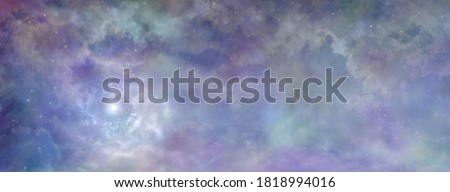 Heavenly clouds celestial  background banner - beautiful blue pink purple green lilac light filled heavenly ethereal cloudscape depicting the heavens above   Royalty-Free Stock Photo #1818994016