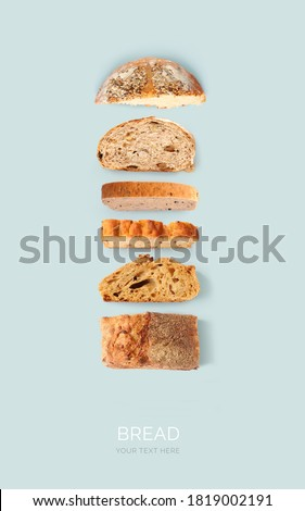 Creative layout made of bread on the blue background. Flat lay. Food concept. Royalty-Free Stock Photo #1819002191