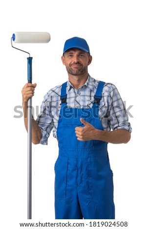 Portrait of male house painter with paint roller showing thumb up isolated on white background