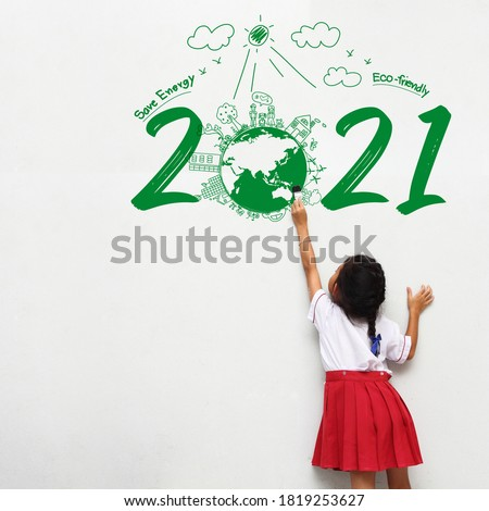 Little girl holding a paint brush painting creative environmental and eco-friendly, Save energy 2021 new year #1819253627