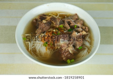 """A picture  of """"bihun sup tulang"""" or bone soup on the table serve for breakfast."""