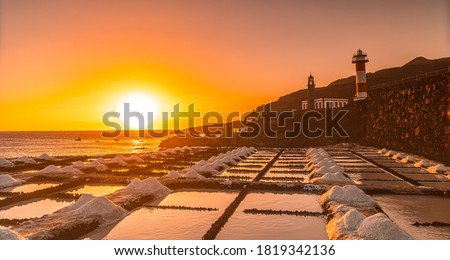 Sunset at the Fuencaliente Lighthouse next to the salt flats, on the route of the volcanoes south of the island of La Palma, Canary Islands, Spain Royalty-Free Stock Photo #1819342136