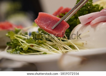 a picture of tuna sashimi cooking