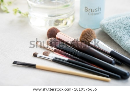 Makeup brush cleaning set: a variety of dirty brushes, brush cleanser liquid, a jar of water and dry soft towel. Cleaning maleup brushes every 3 month to get rid of bacteria, dead skin cells and oil. #1819375655