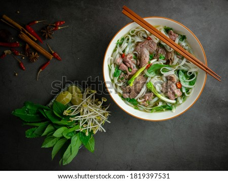 Phở Bò - Traditional Vietnamese beef noodle soup Royalty-Free Stock Photo #1819397531