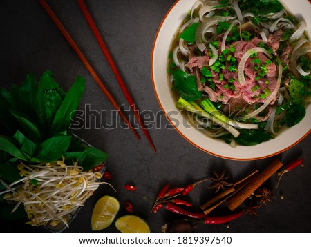 Phở Bò - Traditional Vietnamese beef noodle soup Royalty-Free Stock Photo #1819397540
