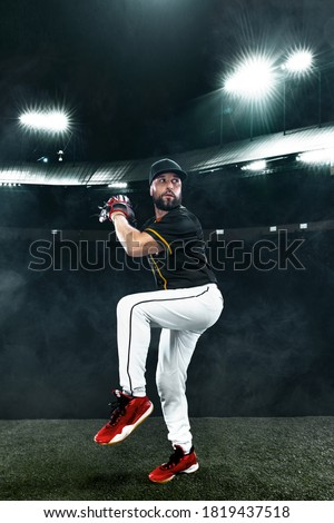 Porfessional baseball player with ball on grand arena. Ballplayer on stadium in action. Royalty-Free Stock Photo #1819437518