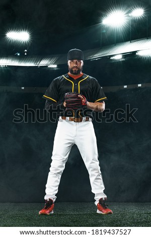 Porfessional baseball player on grand arena. Ballplayer on stadium in action. Royalty-Free Stock Photo #1819437527