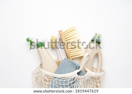 Eco brushes and rag on white background. Flat lay eco cleaning products. Cleaner concept  Royalty-Free Stock Photo #1819447619