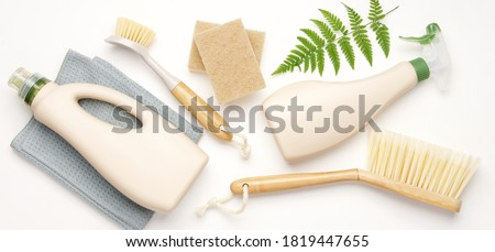 Eco brushes, sponges and rag on white background. Flat lay eco cleaning products. Cleaner concept  Royalty-Free Stock Photo #1819447655