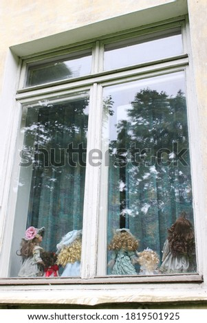 Photos of children's toys on the window #1819501925