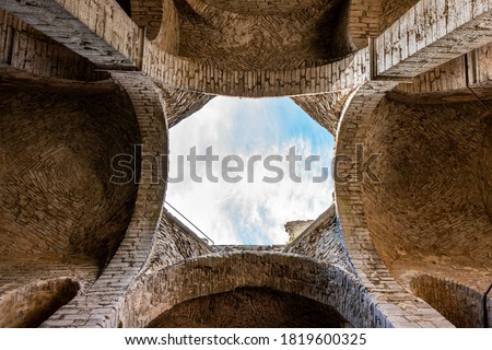 Inside architecture ceiling with opening. Arches of an ancient medieval church ruin with blue sky in Visby Gotland Sweden. Historical ruins with free entry. Royalty-Free Stock Photo #1819600325