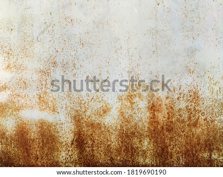 Corroded metal background. Rusted grey painted metal wall. Rusty metal background with streaks of rust. Rust stains. The metal surface rusted spots. Rystycorrosion. #1819690190