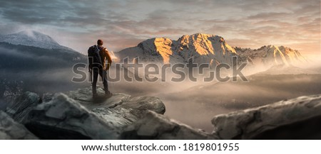 Hikers on a summit in a wintry mountain landscape Royalty-Free Stock Photo #1819801955