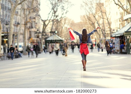 Barcelona, La Rambla shopping woman. Female shopper walking happy away with shopping bags raised up. From the famous landmark street in Catalonia, Spain. #182000273