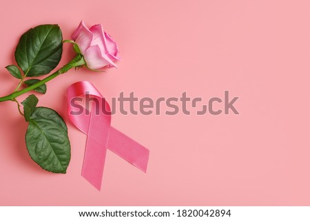 Pink ribbon and rose on pink background. Breast cancer awareness month concept #1820042894