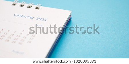 calendar page 2021 close up on blue background business planning appointment meeting concept #1820095391