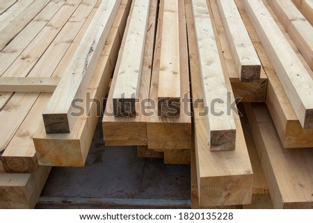 Large wooden beams for construction. Building material. Sawed beam Royalty-Free Stock Photo #1820135228