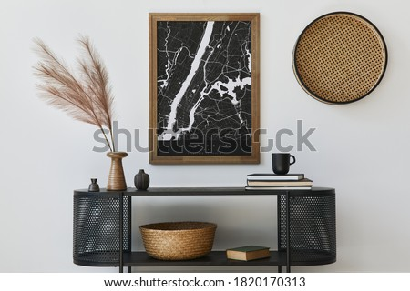 Modern scandinavian home interior with design wooden commode, mock up poster map, feather in vase, book and personal accessories in stylish home decor. Template. Royalty-Free Stock Photo #1820170313