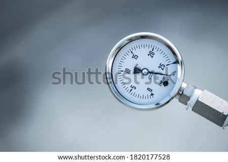 Industrial bar pressure indicator. Air, gas and oil pressure gauge at the factory plant installed on a pipeline. Royalty-Free Stock Photo #1820177528