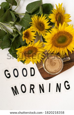 Good Morning. A bouquet of large sunflowers and hot coffee. Sunflower arrangement flat lay style on background white