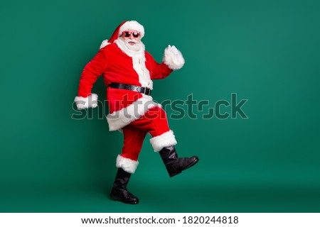 Full body size profile photo of retired grandpa funny walk together elves deer buy present gift kids wear red santa costume coat gloves sunglass cap isolated green color background