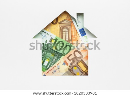 Euro banknotes in paper house symbol. Real estate, property investment, home mortgage loan rate, utility bills, top view, flat lay  Royalty-Free Stock Photo #1820333981