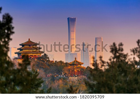 Sunset Beijing cityscape between ancient chinese architecture. historic buildings and  Beijing modern building with sweet sun rise sky, Beijing, China