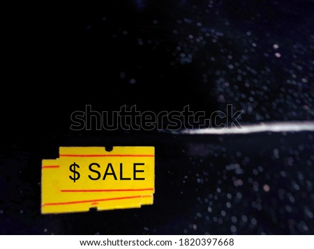 $ SALE text written on price tag label sticker with black background. Business concept. Stock photo.