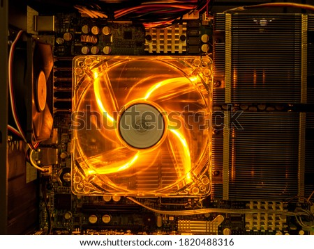 cooling fan with backlight in the computer system unit, cooling the computer air, repair and upgrade, cooling computer components Royalty-Free Stock Photo #1820488316