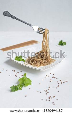 spaghetti made from buckwheat on a white table