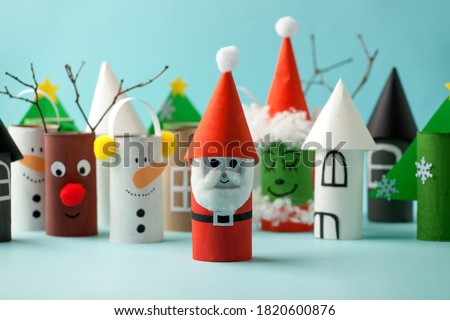 Decoration for Winter season home party - toys made with toilet paper roll. Handicraft snowman, concept of eco-friendly reuse recycle diy creative idea for Christmas and New Year Royalty-Free Stock Photo #1820600876