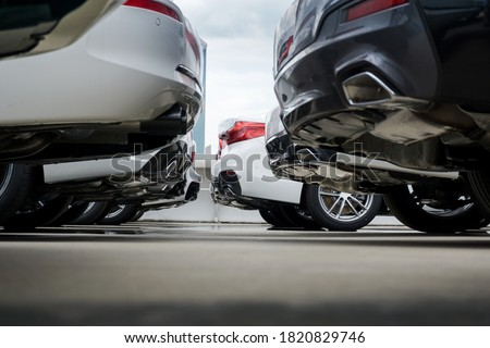 Selective focus of Cars for sale parking lot in dealership . Image of body Rear car with rear bumper and rear light awaiting new owners. Royalty-Free Stock Photo #1820829746