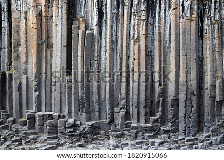 The wall of basalt columns in Studlagil canyon in Jokuldalur Valley in Iceland. Texture of a volcanic basalt rock. Royalty-Free Stock Photo #1820915066