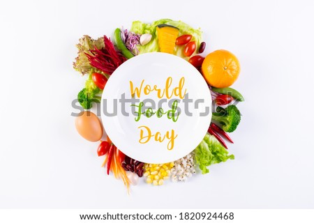 World food day, vegetarian day, Vegan day concept. Top view of fresh vegetables, fruit, with text in plate on white paper background. #1820924468