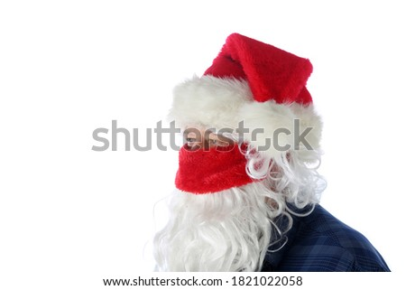 Casual Santa Claus Covid-19. Santa Wears a Blue Shirt, Santa Hat, Protective Face Mask on a causal day before Christmas. Isolated on white. Coronavirus is Dangerous even for Santa. #1821022058